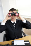 Young businessman looking through binoculars Stock Photography
