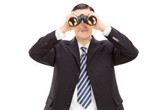 Young businessman looking through binoculars Royalty Free Stock Photo