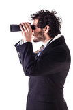 Young businessman looking through binoculars Royalty Free Stock Image