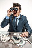 Young businessman looking through binoculars Royalty Free Stock Photography