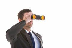 Young businessman looking through binoculars Royalty Free Stock Photo