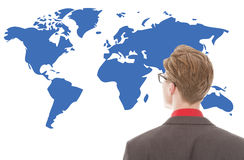 Young businessman looking at blue world map isolated Stock Photography