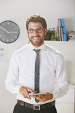 Young businessman looking a camera with digital tablet. Royalty Free Stock Photos