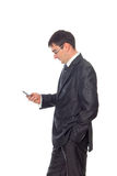 Young businessman looking at cell phone. Isolated image Stock Image