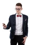 Young businessman looking at cell phone Royalty Free Stock Photography