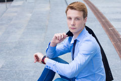 Young businessman looking at the clock and waiting for the client Stock Images