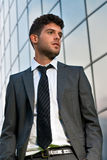 Young businessman looking future modern building Stock Photo