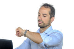 A young businessman looking at his watch Royalty Free Stock Photo
