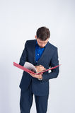 Young businessman looking information in a folder Stock Photography