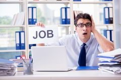 The young businessman looking for job in unemployment concept Stock Images