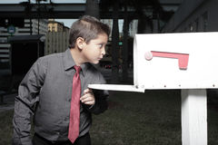 Young businessman looking in a mailbox Stock Photos