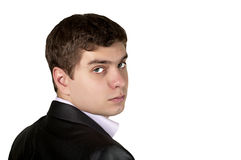 Young businessman looking over his shoulder. Serious businesswoman looking over his shoulder Royalty Free Stock Photos