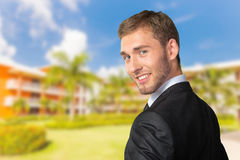 Young Businessman. Looking over his shoulder stock photo