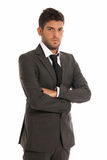 Young businessman looking serious arms crossed. Isolated on white background royalty free stock photography
