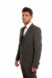 Young businessman looking serious isolated. On white background Stock Photos