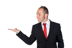 Young businessman looking something on his hand Stock Photos