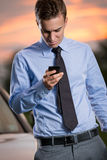 Young businessman looking ta smart   phone Stock Images