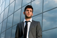 Young businessman looking to good future building stock photo