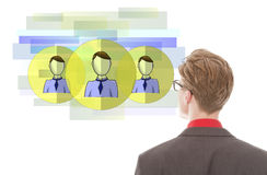 Young businessman looking at virtual friends isolated Royalty Free Stock Photo