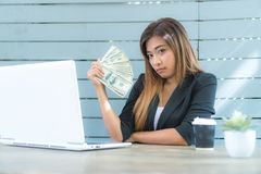 Young businessman With lots of money. She expressed her success royalty free stock photography