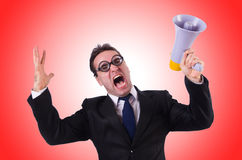 Young businessman with loudspeaker against the Royalty Free Stock Photos