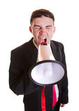 Young businessman with loudspeaker Royalty Free Stock Image