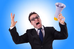 Young businessman with loudspeaker. On white Royalty Free Stock Photos