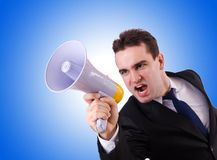 Young businessman with loudspeaker on the white. Young businessman with loudspeaker on white Stock Photography