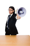 Young businessman with loudspeaker on white Royalty Free Stock Photo