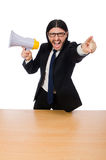 Young businessman with loudspeaker on white. The young businessman with loudspeaker on white Royalty Free Stock Image