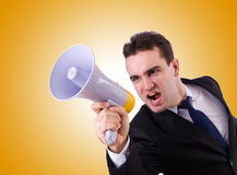 Young businessman with loudspeaker on white. The young businessman with loudspeaker on white Stock Images