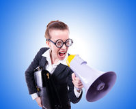 Young businessman with loudspeaker on white Stock Images