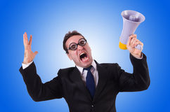 Young businessman with loudspeaker on white. The young businessman with loudspeaker on white Stock Photography