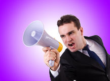 Young businessman with loudspeaker on white Royalty Free Stock Images
