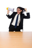 Young businessman with loudspeaker on white. The young businessman with loudspeaker on white Royalty Free Stock Photos