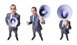 The young businessman with loudspeaker on white Royalty Free Stock Image