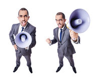 The young businessman with loudspeaker on white. Young businessman with loudspeaker on white Stock Photo