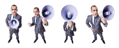 The young businessman with loudspeaker on white Stock Image