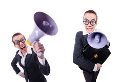 The young businessman with loudspeaker on white Stock Photo