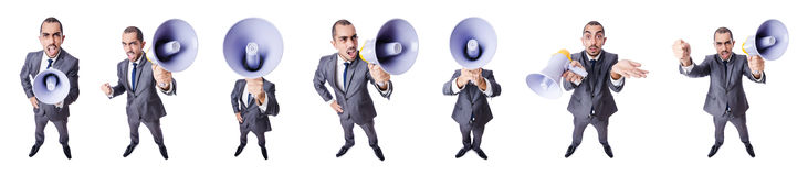 The young businessman with loudspeaker on white. Young businessman with loudspeaker on white Stock Photography