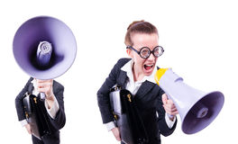 The young businessman with loudspeaker on white. Young businessman with loudspeaker on white Royalty Free Stock Images