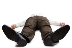 Young businessman lying on the floor stock photo