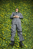 Young Businessman Lying in Flower Patch Stock Photography