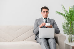 The young businessman lying on the sofa Stock Images