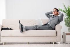The young businessman lying on the sofa Royalty Free Stock Photo