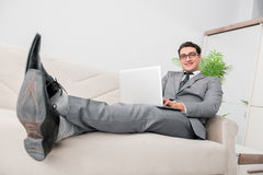 The young businessman lying on the sofa Royalty Free Stock Photography