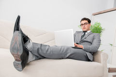 The young businessman lying on the sofa Royalty Free Stock Photos