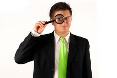 Young businessman with magnifying glass Stock Photos