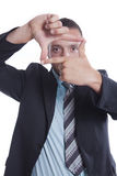 Young businessman make focus sign with his hands Royalty Free Stock Photography