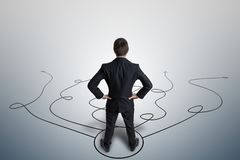 Young businessman is making decision and selecting strategy. View from behind.  Stock Images